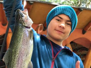 Javier lands a trout before breakfast.